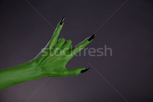 Groene monster hand tonen heavy metal gebaar Stockfoto © Elisanth