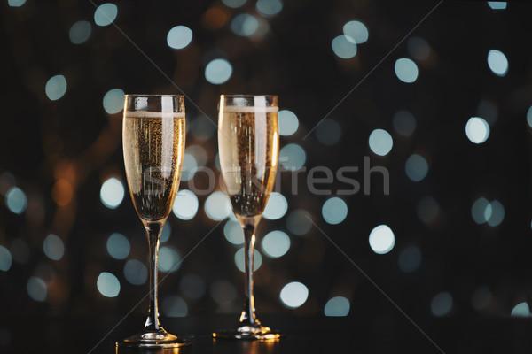 Stock fotó: Kettő · pezsgő · szemüveg · sötét · bokeh · buli