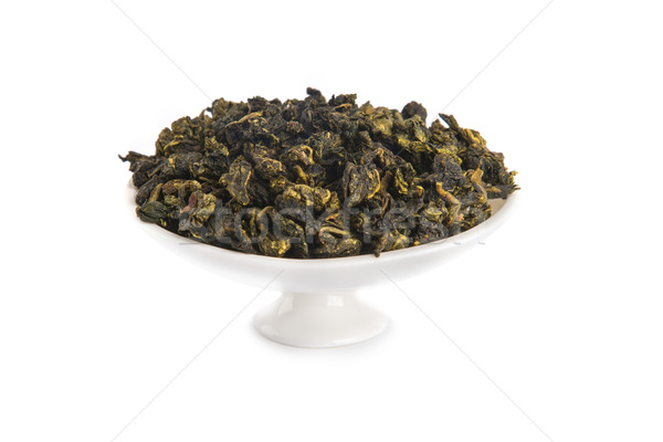Tie Guan Yin Oolong tea on white porcelain container  Stock photo © Elisanth