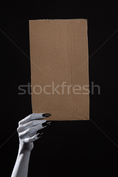 White ghost hand with black nails holding blank cardboard  Stock photo © Elisanth