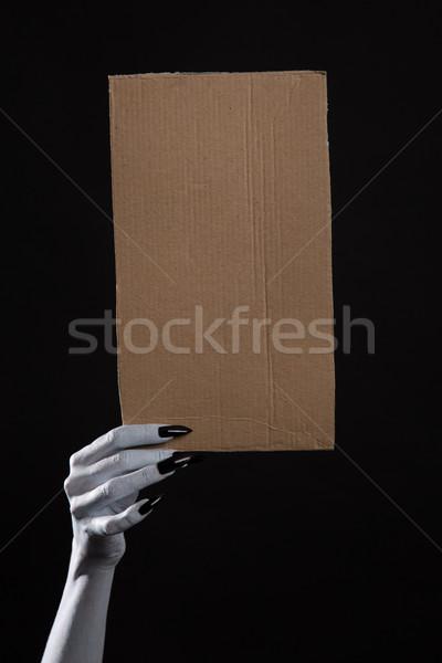 Bianco fantasma mano nero chiodi Foto d'archivio © Elisanth