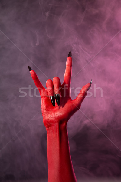 Heavy metal, red devil hand with black nails  Stock photo © Elisanth