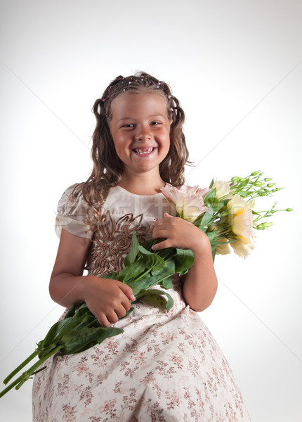 Cute little girl holding flowers  Stock photo © Elisanth