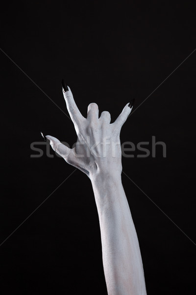 Pale monster hand showing heavy metal symbol  Stock photo © Elisanth