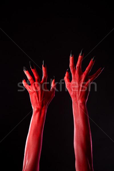 Czerwony demoniczny ręce czarny paznokcie real Zdjęcia stock © Elisanth