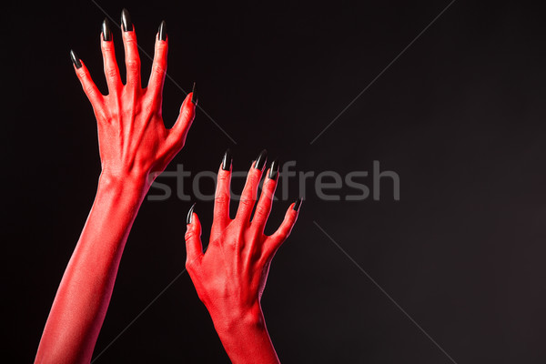 Red devil hands with black nails, real body-art  Stock photo © Elisanth