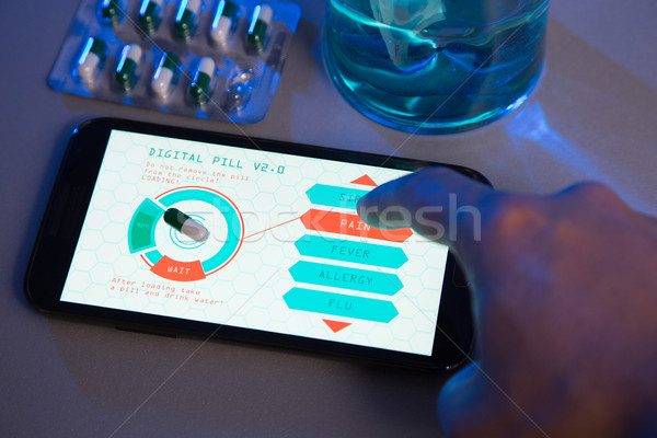 Futuristic medicine concept, choose your pill type on high-tech  Stock photo © Elisanth