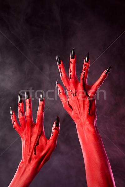 Rosso diavolo mani nero chiodi coperto Foto d'archivio © Elisanth