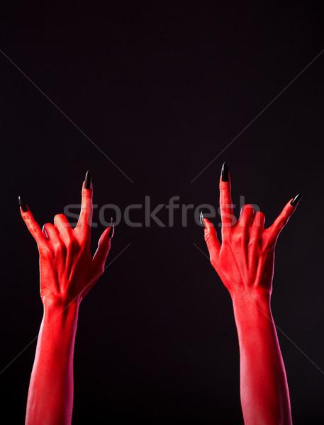 Vermelho assustador mãos heavy metal gesto Foto stock © Elisanth