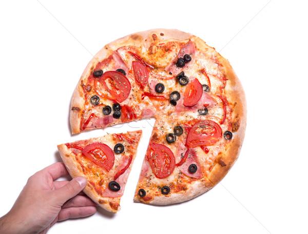Mannelijke hand smakelijk pizza slice geïsoleerd Stockfoto © Elisanth