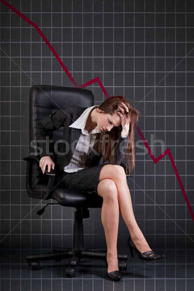 Deprimido mujer de negocios sesión oficina sillón tabla Foto stock © Elisanth