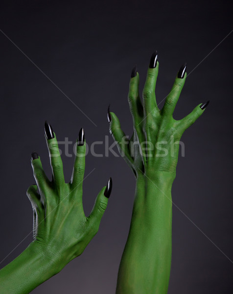 Green witch hands with black nails stretching up, real body-art  Stock photo © Elisanth