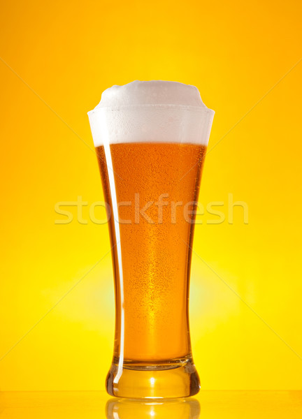 Full glass of beer with froth  Stock photo © Elisanth