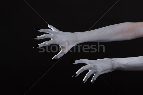 Scary pale ghost hands with black nails  Stock photo © Elisanth