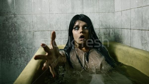 Scary girl in bath  Stock photo © Elisanth
