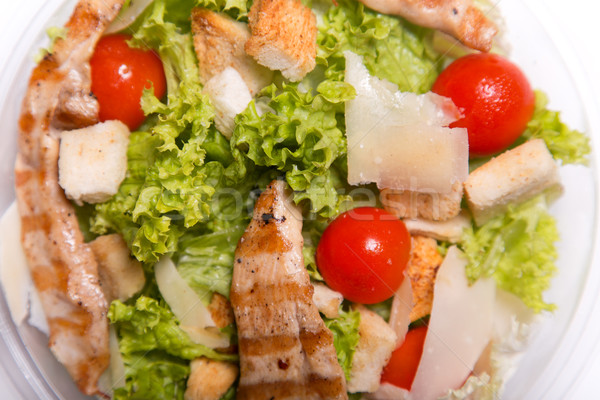 Delicious Caesar salad with grilled chicken meat  Stock photo © Elisanth