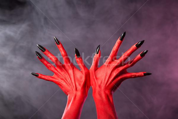 Czerwony diabeł ręce ostry czarny paznokcie Zdjęcia stock © Elisanth
