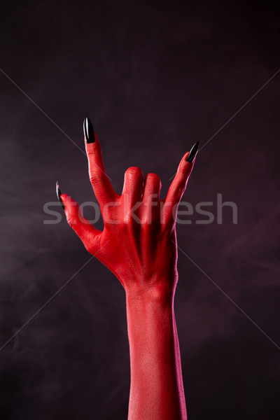 red devil hand showing heavy metal gesture stock photo elisanth