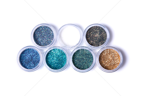 Two rows of metallic glitters in jars   Stock photo © Elisanth