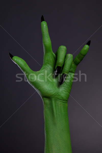 Green hand with black nails showing heavy metal gesture  Stock photo © Elisanth
