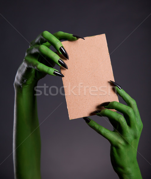 Green monster hands holding empty piece of cardboard  Stock photo © Elisanth
