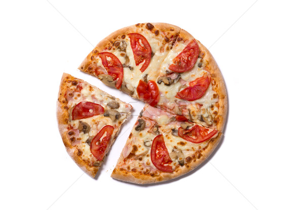 Tasty Italian pizza with ham and tomatoes with a slice removed  Stock photo © Elisanth