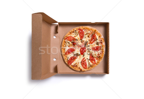 Delicious Italian pizza with ham and tomatoes in box  Stock photo © Elisanth