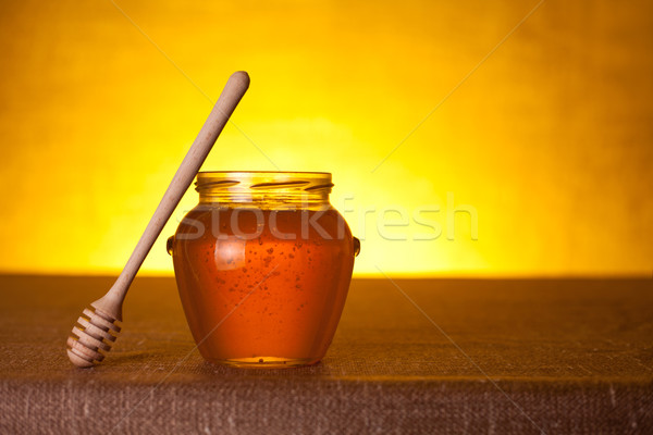Glass honey jar with dipper  Stock photo © Elisanth