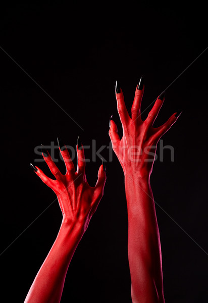 Spooky red demonic hands with black nails, real body-art  Stock photo © Elisanth