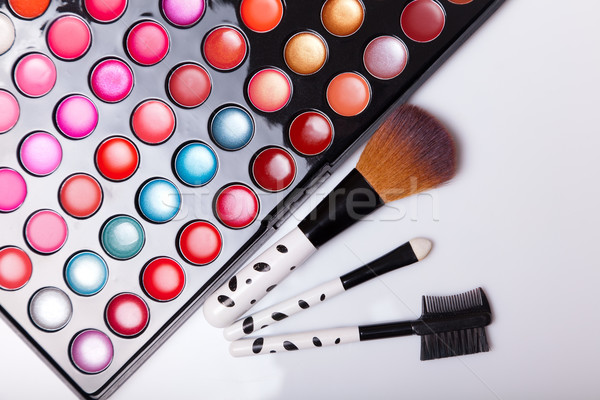 Colorful lip gloss palette with set of brushes  Stock photo © Elisanth