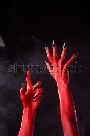 Diabo mão heavy metal gesto isolado Foto stock © Elisanth