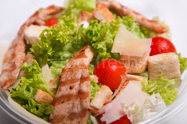 Delicious Caesar salad with chicken meat  Stock photo © Elisanth
