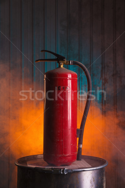 Red fire extinguisher on urban style background  Stock photo © Elisanth