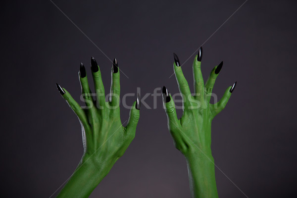 Green monster hands with sharp black nails, body-art  Stock photo © Elisanth