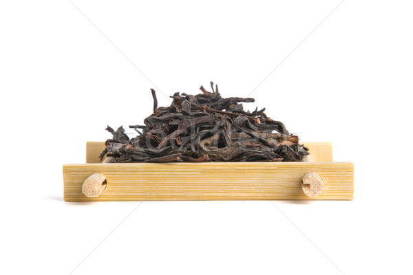 Studio shot of Honey Orchid Oolong on bamboo serving tray Stock photo © Elisanth