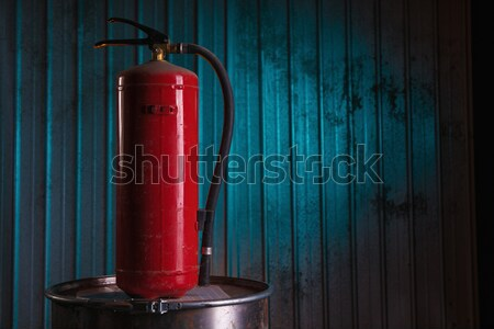 Fire extinguisher on old rusty barrel Stock photo © Elisanth