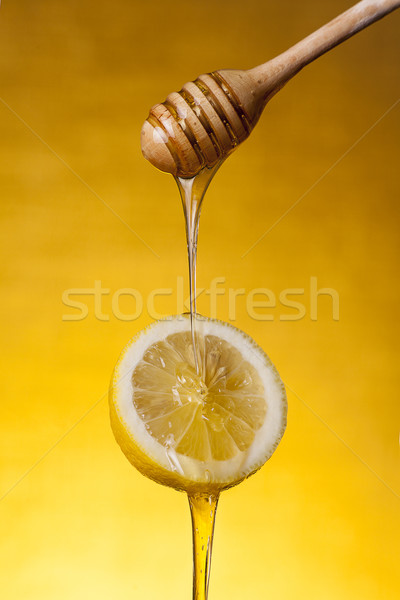 Close-up shot of honey flowing on lemon  Stock photo © Elisanth