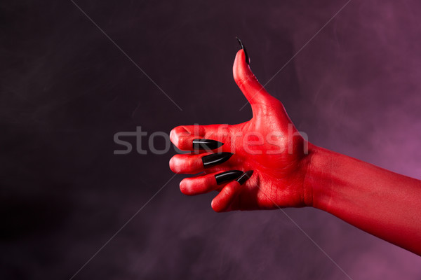 Red devil hand showing thumbs up  Stock photo © Elisanth