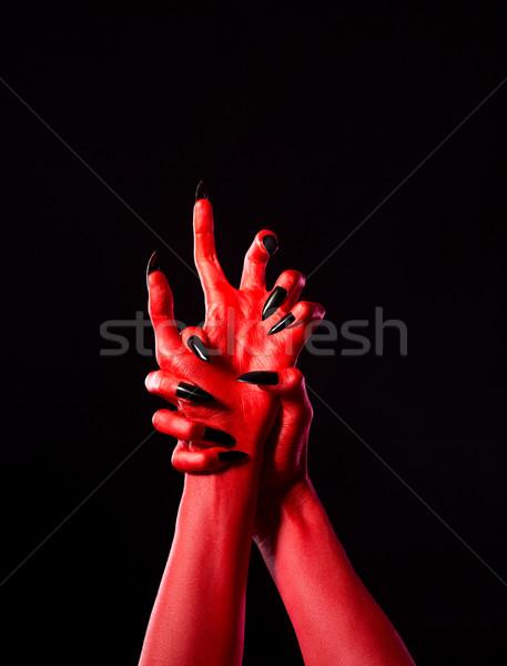 Vermelho demoníaco mãos preto unhas real Foto stock © Elisanth