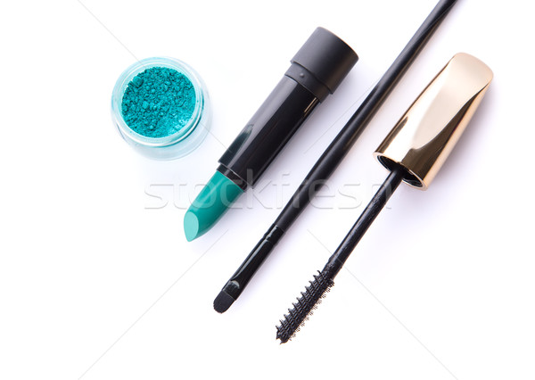 Top view of loose eye shadow, lipstick, makeup brush, and mascar Stock photo © Elisanth