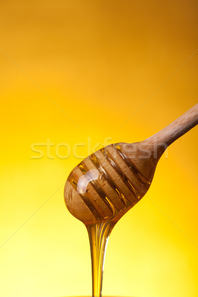 Close-up shot of wooden dipper and flowing honey  Stock photo © Elisanth