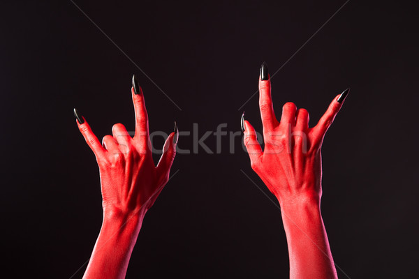 Stock photo: Red devil hands showing heavy metal