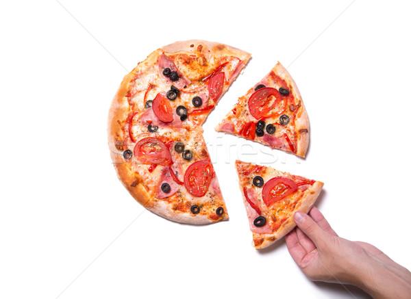 Mannelijke hand smakelijk pizza slice top Stockfoto © Elisanth