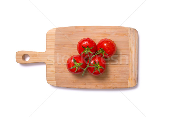 Top view of fresh juicy tomatoes on chopping board  Stock photo © Elisanth