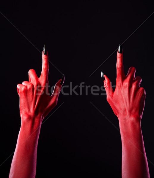 красный дьявол рук указывая пальцы вверх Сток-фото © Elisanth