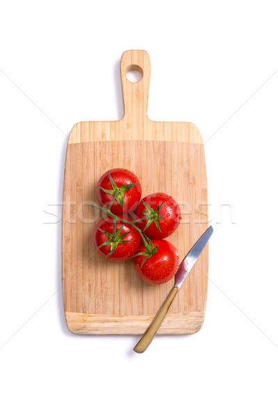 Superior vista frescos tomates cuchillo tabla de cortar Foto stock © Elisanth