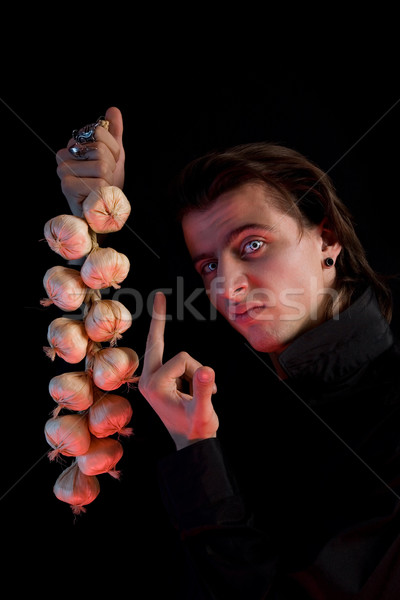 Handsome vampire is not scared by garlic  Stock photo © Elisanth