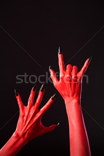 Red devil hands with long black nails, real body-art  Stock photo © Elisanth