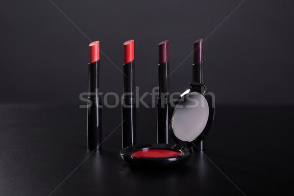 Szett piros krém bőrpír stúdiófelvétel fekete Stock fotó © Elisanth