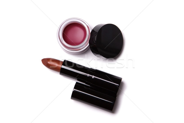 Top view of metallic red lipstick and lip gloss in jar   Stock photo © Elisanth